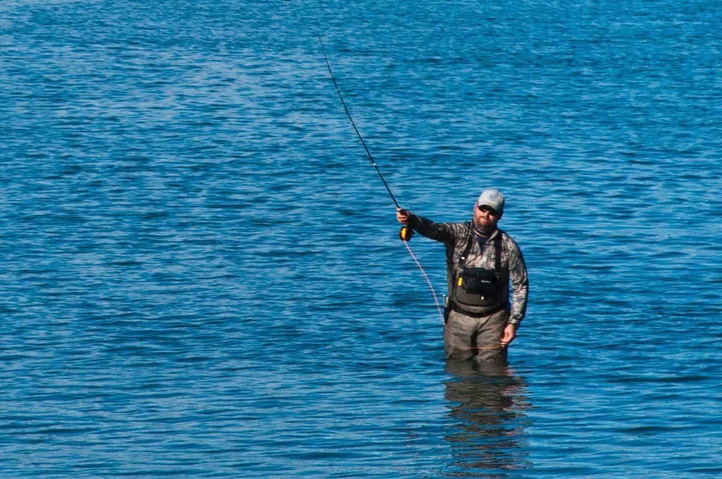 This sport fisher couldn't have had a better Sunday, fishing for Coho salmon under bluebird skies in the waters of Orca Inlet. Photo by Cinthia Gibbens-Stimson/The Cordova Times