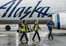 Alaska Airlines' customer service agent Kate Velasco and local station manager Deb Ethier visit with Brad Tilden, the airline's chief executive officer, as they walk around the last combi jet. Photo by David Little/For The Cordova Times
