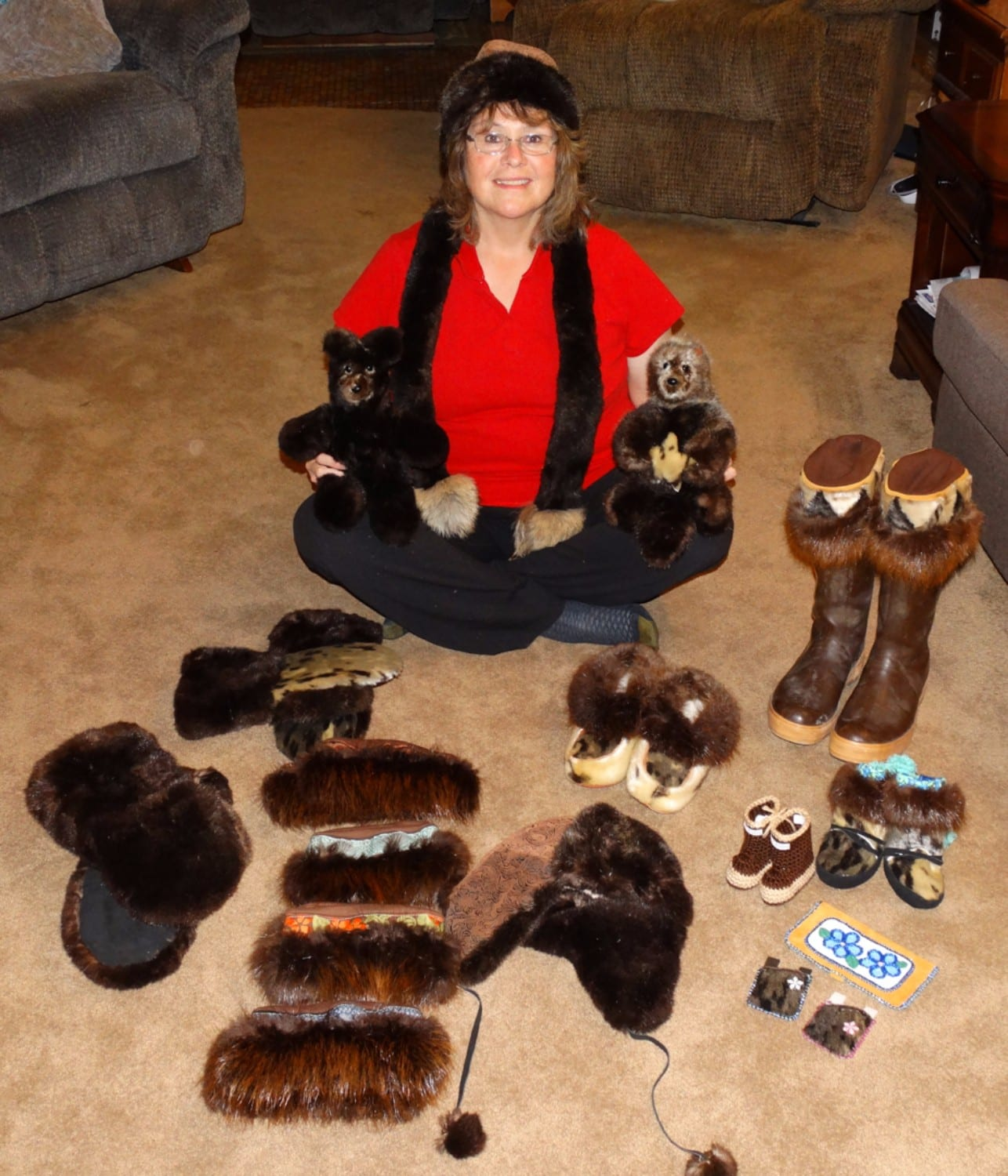 Alaska Native handicraft artist Gloria Cunningham makes gloves, hats, mittens, teddy bears, sea otters, slippers, boot toppers, baby booties and more, from locally sourced Alaskan furbearing animals, and embellishes many of her creations with beadwork. Photo courtesy Gloria Cunningham/For The Cordova Times