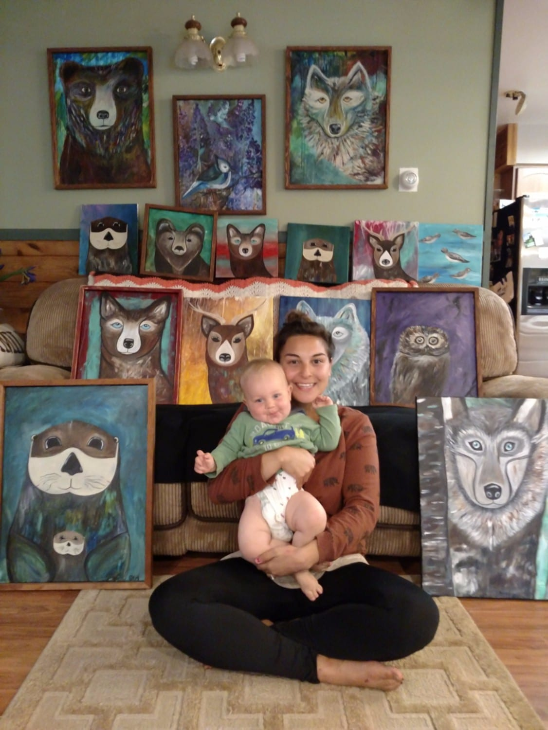 Artist Brittany Banks, pictured here two years ago with her son, Brandon, now 3 years old, paints colorful images of Alaska's animals, family name signs and welcome signs. Her original designs are also available on coffee mugs, cards, and clothing. Photo courtesy Brittany Banks/For The Cordova Times