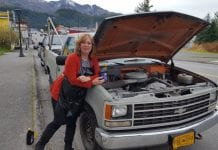 Between haircuts, Shag's April Horton shows what conditioner it takes to make a truck run smoothly. Photo by Dick Shellhorn/The Cordova Times