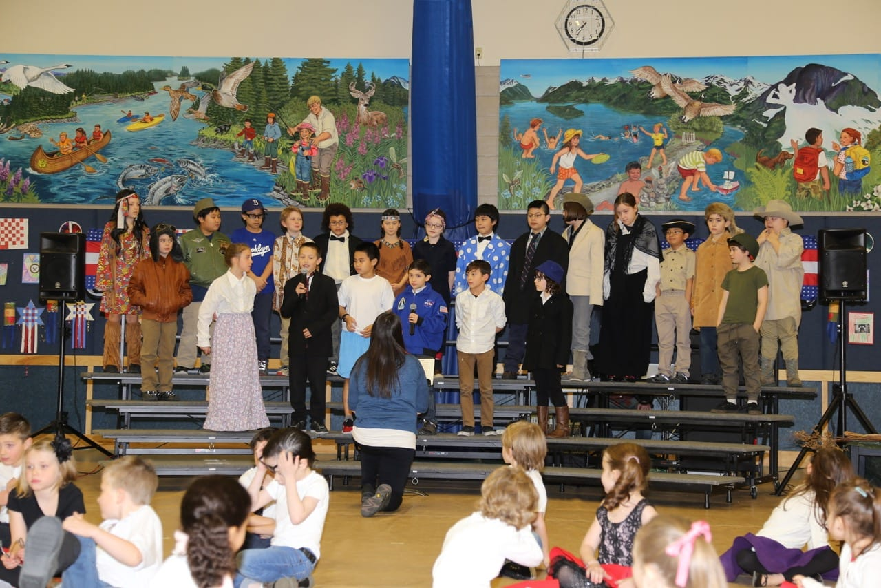 Twenty-one fourth graders, each portraying a famous American, provided voices celebrating our history from Armistice to the Moon. Photo by Susan Harding/For The Cordova Times