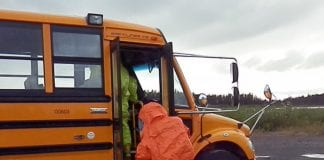 Cordova Volunteer Fire Department member Dustin Solberg and Idaho Civil Support Team member enter the bus, serving in place of an aircraft, to find the weapon of mass destruction. Photo courtesy of Cordova Volunteer Fire Department
