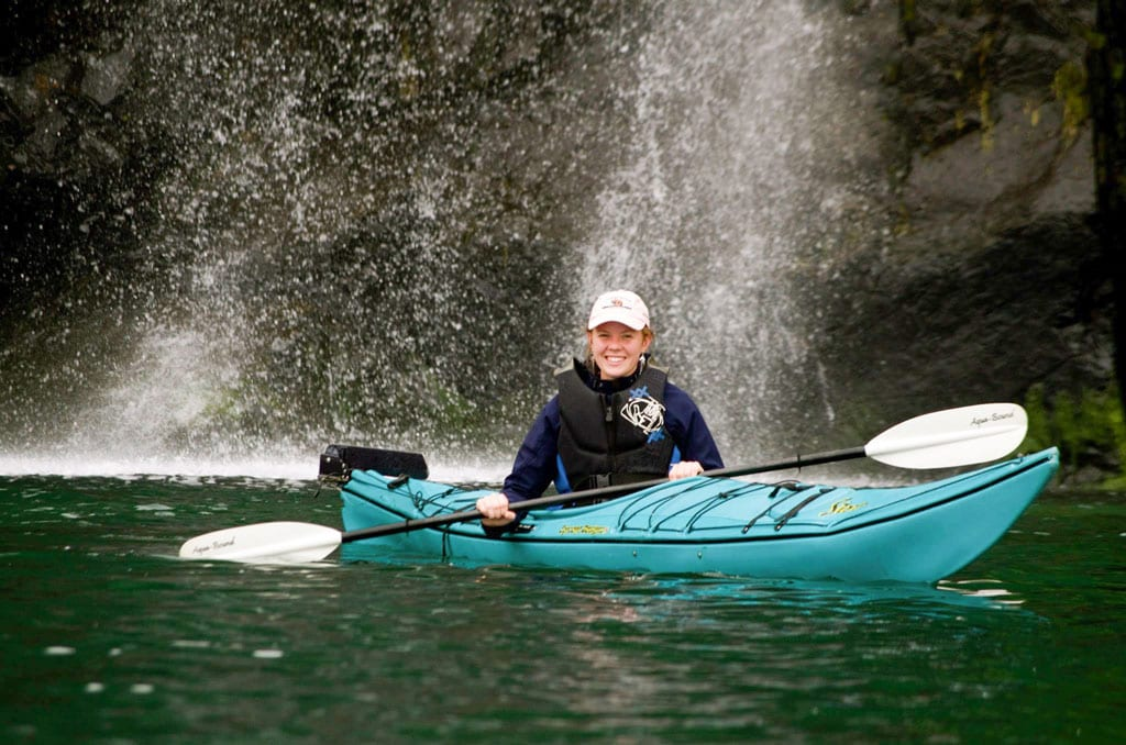 Erin Ranney, Steve and Wendy Ranney's niece, explores waterfalls in Prince William Sound in a sea kayak from Orca Adventure Lodge. Gift certificates for sea kayak rentals are available; the cost is $65 per boat/per day. Photo by Scott Ranney/For The Cordova Times