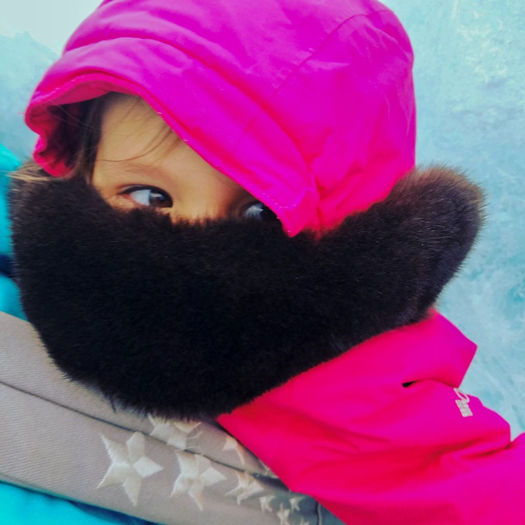 Elora Riedel, daughter of Diana Riedel, wore a sea otter fur headband and scarf, which protected her from the cold and wind while exploring ice caves outside Cordova with her family. Photo courtesy Dineega Furs/For The Cordova Times