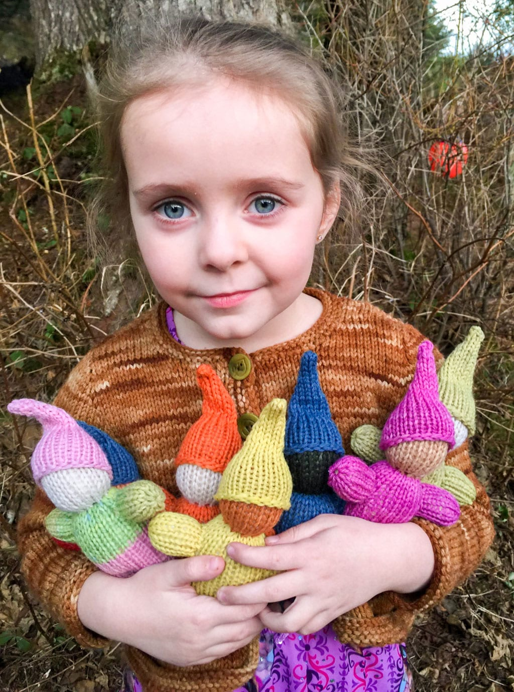 Astrid Wasson with a handful of natural dyed yarn Waldorf dolls, handmade by Astrid's mother, Amber Wasson. Photo courtesy Rainbow Forest/For The Cordova Times