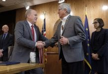 Governor Bill Walker shakes hands with Lieutenant Governor Byron Mallott after signing an Administrative Order on Climate Change, at the State Capitol in Juneau, Alaska, October 31, 2017.