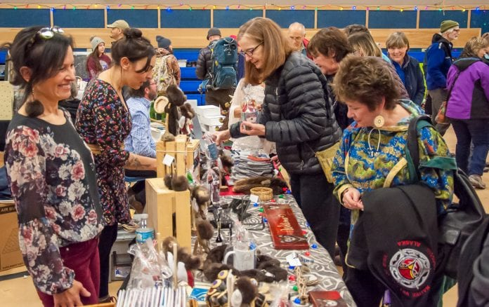 From left, vendors Mary Babic and Brittany Banks talk to Torie Baker and Belen Cook while they shopped at the holiday bazaar Dec. 1. Photo by Cinthia Gibbens-Stimson/The Cordova Times