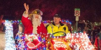 Santa Claus, with Cordova Volunteer Fire Department Chief Mike Hicks, arrived to light the community Christmas tree on the evening of Dec. 1, on Main Street. Photo by Cinthia Gibbens-Stimson/The Cordova Times