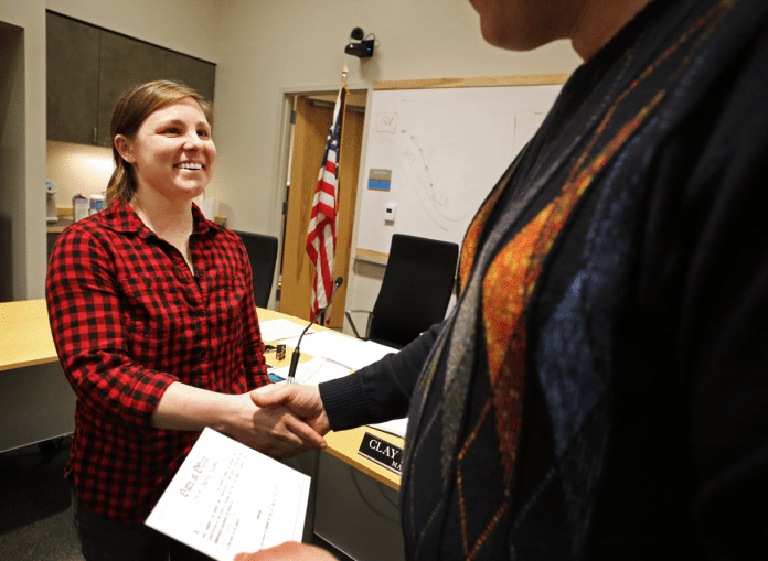 "Anne Schaefer completes her oath of office, delivered by Mayor Clay Koplin, after the city council meeting on Wednesday, Dec. 6. ""I'm really excited to serve as a city council member for Cordova and I'm really thankful for all of the support I got from the community,"" Schaefer said. Emily Mesner/The Cordova Times"
