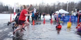 More than 1,000 people took the Polar Plunge into Goose Lake in Anchorage on Dec. 16, raising $300,000 for Special Olympics Alaska summer and winter games for athletes with special needs. While Cordova has no specific Special Olympics program, the organization said a few Cordova residents do participate in its summer camp. Photo by Margaret Bauman/The Cordova Times