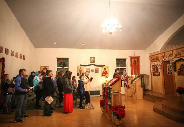 Members of St. Michael's Russian Orthodox Church in Cordova gather and sing during the last night of Russian Christmas on Tuesday, Jan. 9, 2018. Photo by Emily Mesner/The Cordova Times