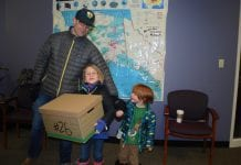 Sam Snyder, engagement director for Trout Unlimited, with his children, Finn, 6, and Deacon, 4, helped deliver boxes of petitions in support of putting the Stand for Salmon petition on the Alaska ballot during a 2018 election. Photo by Margaret Bauman/The Cordova Times