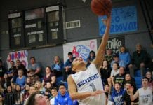 With fans, players, and CHS Coach Bert Adams looking on, Cordova's Dauri Rodrigues goes up for a lay-in over an ACS defender in Tipoff action on Jan. 19. Photo by Mikie McHone/for The Cordova Times