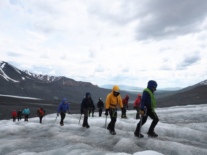 As part of the Girls on Ice program, the girls learn how to mountaineer as they conduct scientific experiments on the glacier. Photo by Alexandra Ravelo