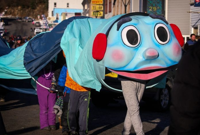 The parade Iceworm makes its way down Main Street on Saturday, Feb. 3, 2018. Photo by Emily Mesner/The Cordova Times