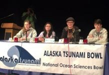 From left, MiKita DeCook, Marie Jamille Esguerra, Cori Pegau and Reid Williams, of the team 'Yeti Crabs', take the stage in front of 200 people before the final and championship round of the buzzer competition during the Alaska Tsunami National Ocean Sciences Bowl. Photo by Lauren Bien/for The Cordova Times