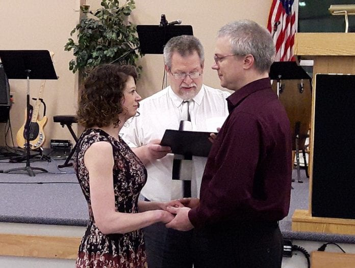 Tracy and Andrea Whitcomb of Cordova renew their marriage vows, officiated by Pastor Larry Goodall, on Feb. 12 at The Little Chapel in Cordova. Photo by Penny Johnson/for The Cordova Times