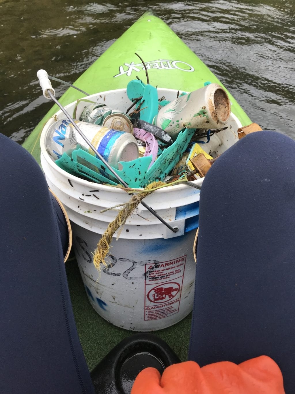 A bucket of garbage retrieved from Eyak Lake. The Saturday, July 27, 2019, cleanup organized by the Copper River Watershed Project and the Forest Service removed 12 cubic yards of waste from around Eyak Lake. Photo courtesy Bella Thurber