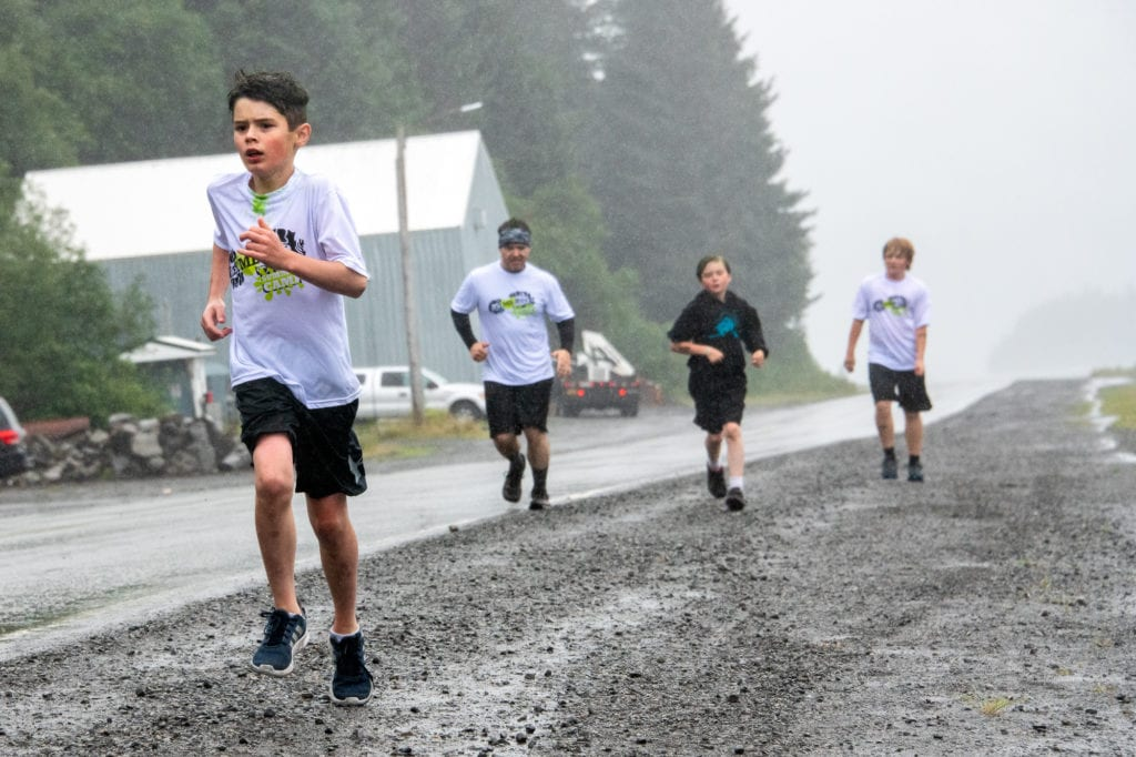 From left: JT Anderson, Nate Taylor, Robert Taylor and Lehi Fish participate in the 5k Amazing Race run. The team-based race, held on Friday, July 26, 2019, was the culmination of Let Me Run, a five-day summer camp for boys.Photo by Zachary Snowdon Smith/The Cordova Times