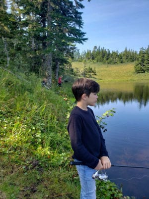 From front: Austin Schandel, Andrew Bellefeauille and Lehi Fish. Children participating in the Hike and Fish day camp on Monday, Aug. 12, 2019, learned about ecology and fishing. Photo courtesy Emily Stoddard