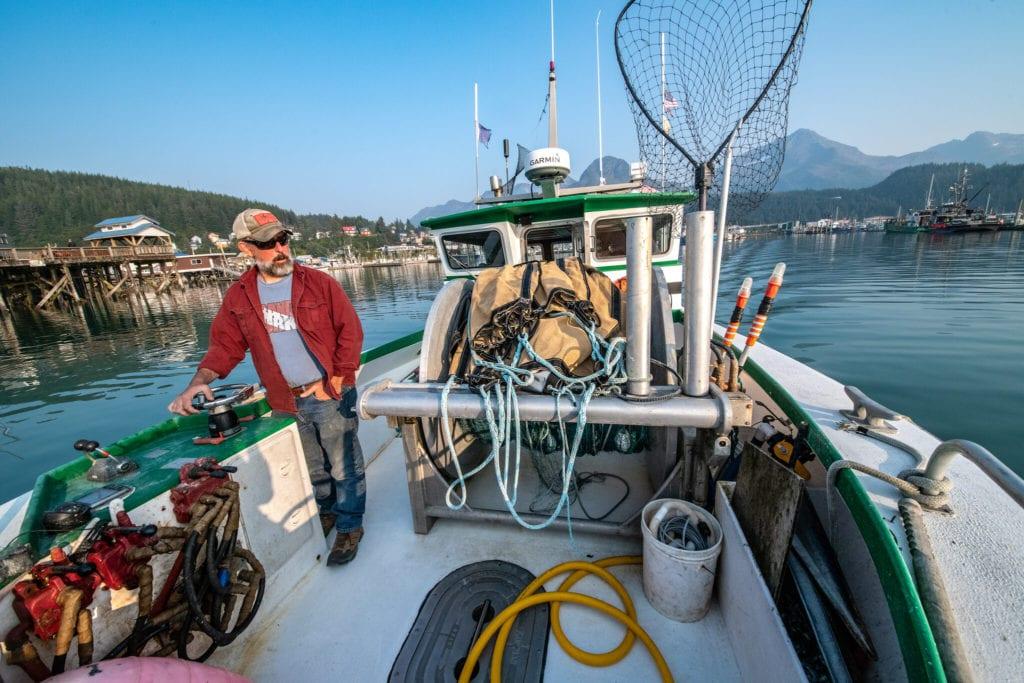 Fisherman Bret Bradford pilots the F/V Nerka out of Cordova Harbor. (Aug. 21, 2019) Photo by Zachary Snowdon Smith/The Cordova Times