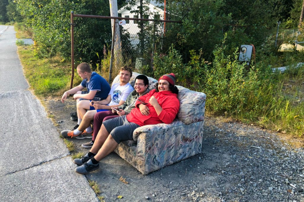 From left: Mike Glasen, Cody Shaw, Justin Lim and Brian Allison lounge around on Chase Avenue. Photo courtesy of David Glasen