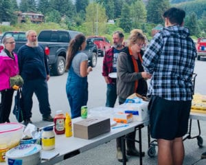 Cordova Jr./Sr. High School boys basketball team serves up food at a fundraiser outside AC Value Center in Cordova. The money raised will help the team travel to games outside Cordova. Photo courtesy of CHS basketball