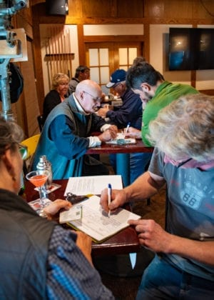 A signature drive for an application to petition to recall Gov. Mike Dunleavy, held at the Reluctant Fisherman Inn. (Aug. 1, 2019) Photo by Zachary Snowdon Smith/The Cordova Times