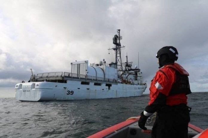 A crew member aboard a 26-foot boat prepares to come alongside Coast Guard Cutter Alex Haley while underway in the Bering Sea. (Oct. 20, 2019) Photo courtesy of U.S. Coast Guard District 17