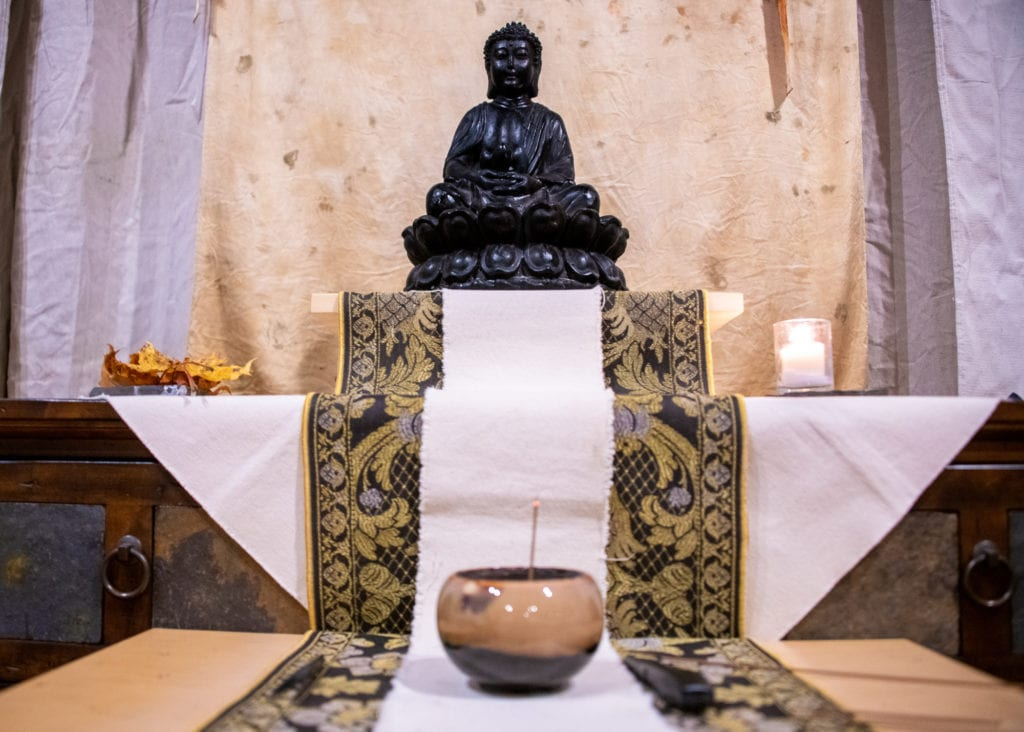 Incense burns at a Buddhist altar. (Nov. 1, 2019) Photo by Zachary Snowdon Smith/The Cordova Times