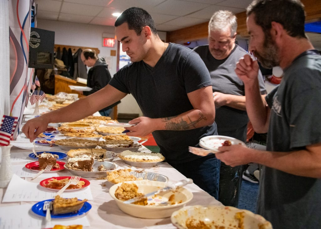 From left, judges Chris Mendez, Per Nolan and Alan Golinsky rate 24 different pies according to flavor, texture, crust and overall presentation. (Nov. 9, 2019) Photo by Zachary Snowdon Smith/The Cordova Times