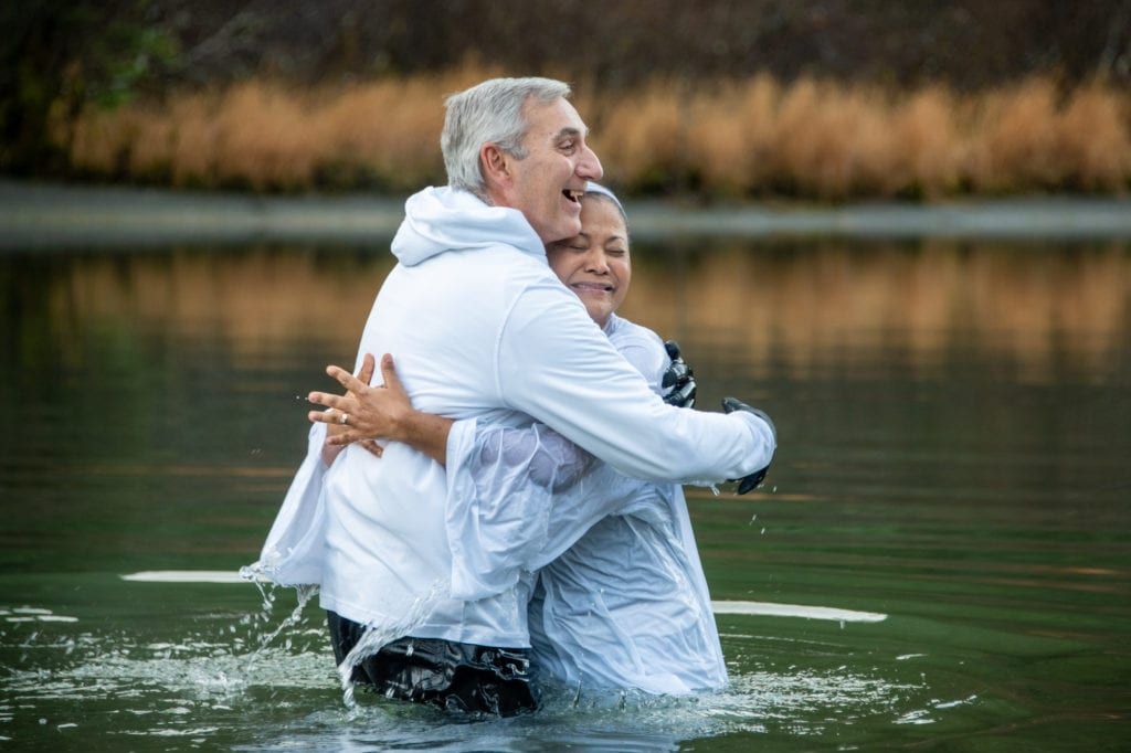 Pastor Steve Leppert baptizes Yaritza Meijas. Despite 39-degree temperatures, Meija preferred to receive baptism in the Eyak River than in a baptismal font. (Nov. 9, 2019) Photo by Zachary Snowdon Smith/The Cordova Times