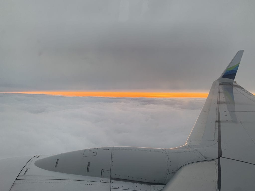 An orange sky peeks through two layers of clouds out the window of Flight 66 bound for Cordova on Nov. 13. Photo by Annette Potter/The Cordova Times