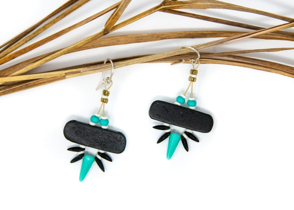 A pair of earrings by Melina Meyer with a bold design and pop of turquoise. Photo by Zachary Snowdon Smith/For the Cordova Times