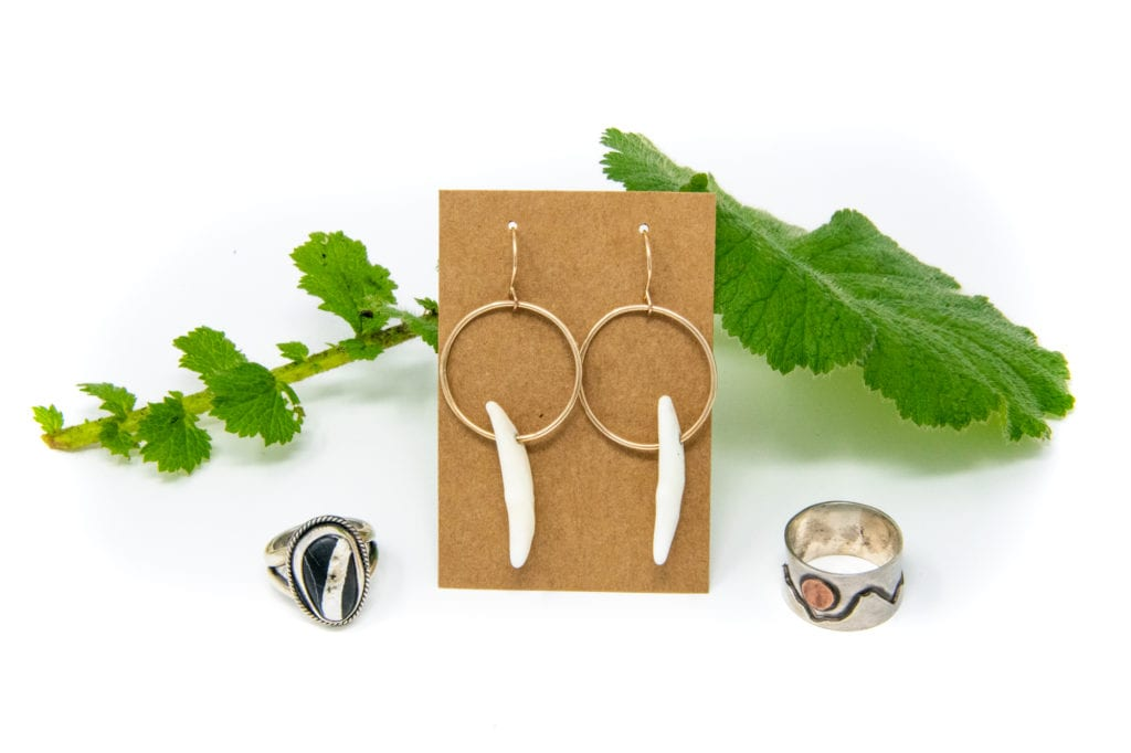 Coyote Teeth earrings and handcrafted metal rings by Shelby Stoltz-Avis. Photo by Jane Spencer/For the Cordova Times