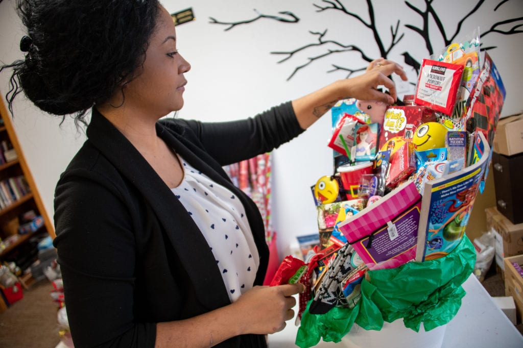 Yaritza Mejias arranges a gift basket for Cordova Family Resource Center's Holiday Gifts on the Go event. (Nov. 22, 2019) Photo by Zachary Snowdon Smith/The Cordova Times