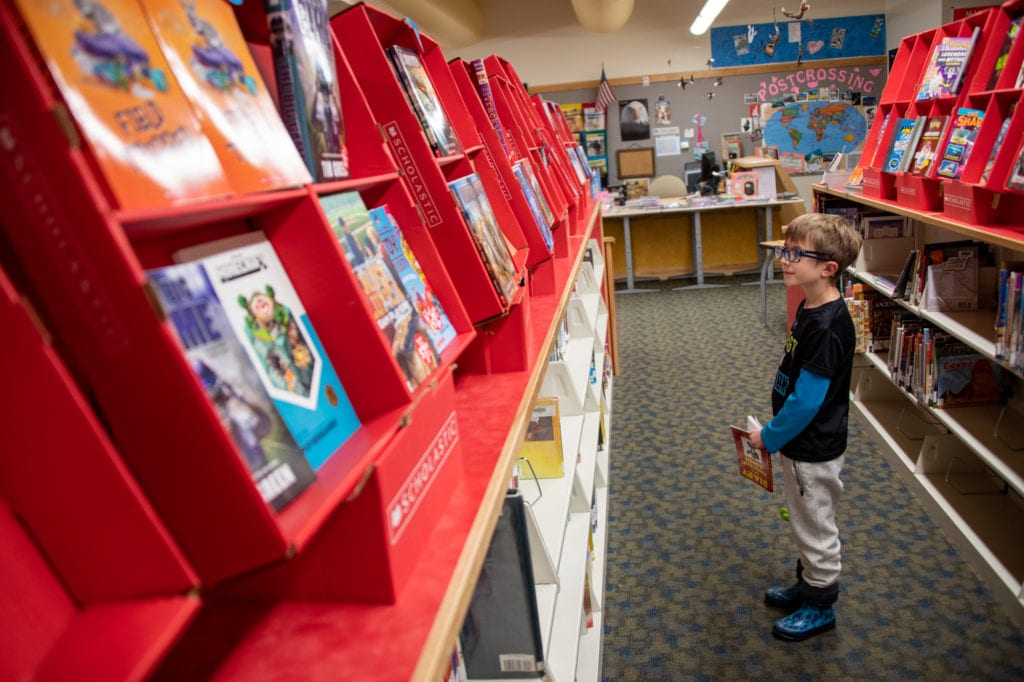 Micah Phillips peruses the Scholastic book fair at Mt. Eccles Elementary School. (Nov. 21, 2019) Photo by Zachary Snowdon Smith/The Cordova Times