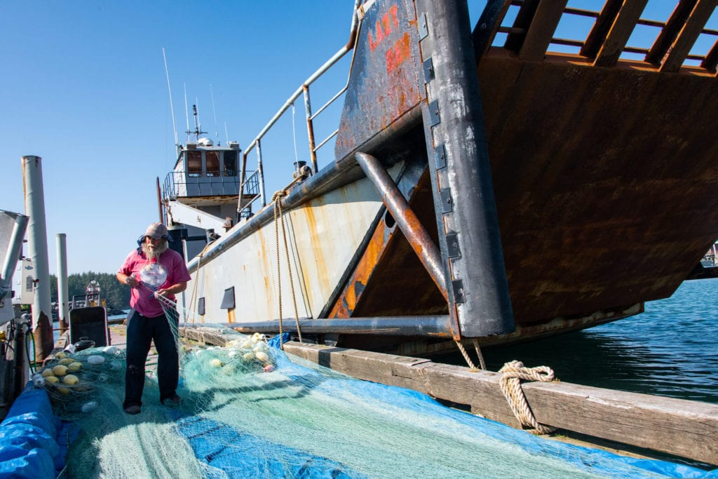 Fisherman William Evans mends a damaged net. (July 7, 2019) Photo by Zachary Snowdon Smith/The Cordova Times