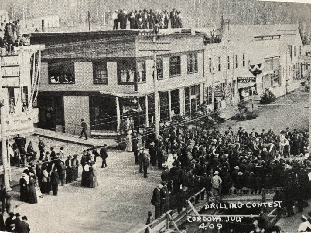 "Onlookers gather on the streets and roofs of the Alaskan and CoHo to watch a ""drilling contest"" as part of the Cordova's July 4, 1909 celebration. Photo courtesy of Cordova Historical Society"