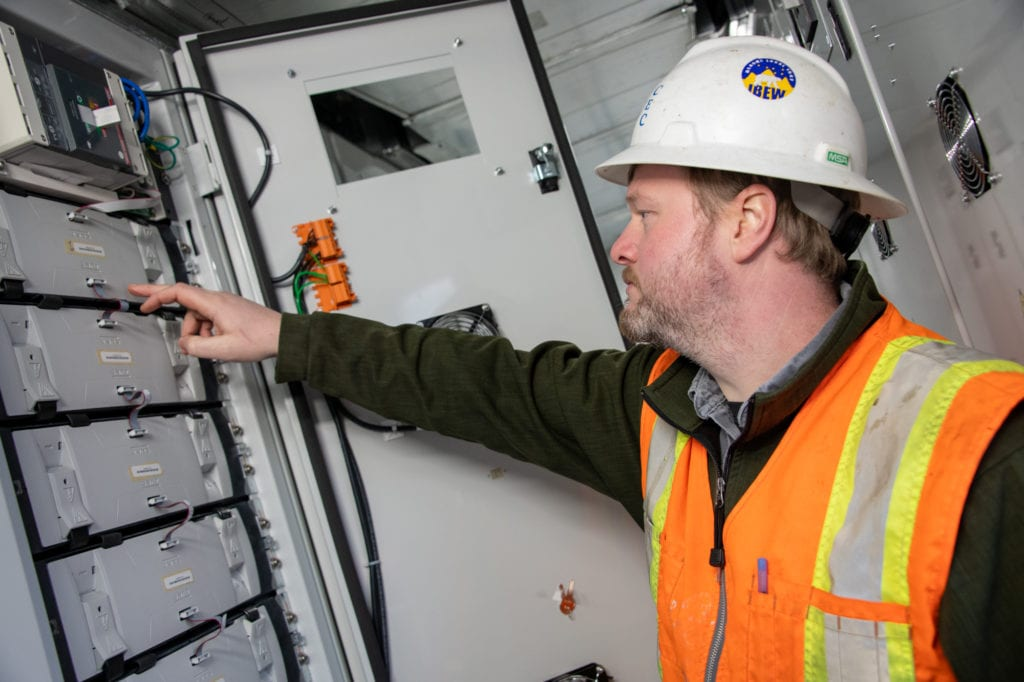 Cordova Electric Cooperative Production Foreman Nate Cain checks the company's newly automated battery. (Dec. 5, 2019) Photo by Zachary Snowdon Smith/The Cordova Times