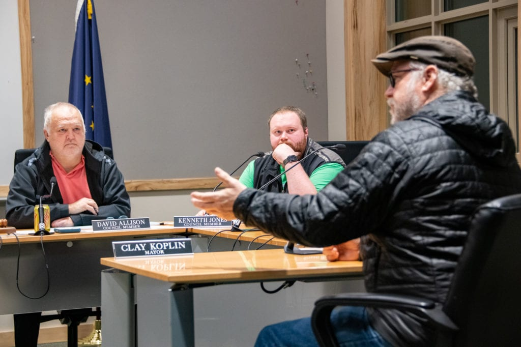 From left, Councilmen David Allison and Kenneth Jones hear comments from resident Robert Beedle on a 6 percent surtax to alcohol, tobacco and marijuana. (Dec. 4, 2019) Photo by Zachary Snowdon Smith/The Cordova Times