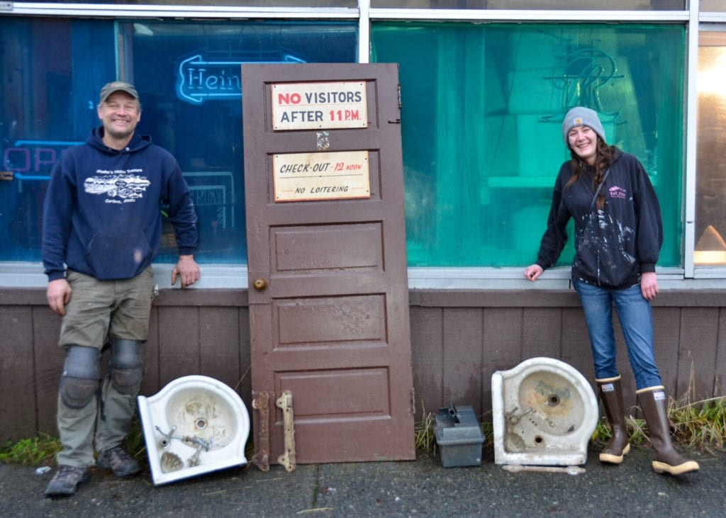 Jeff Thelen and Amanda Adcock smile with their sinks and door from the CoHo. Photo by Jane Spencer/For the Cordova Times