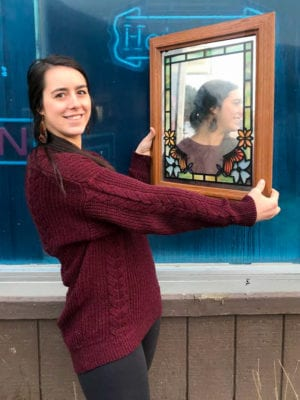 Raven Cunningham with the mirror she won from the CTC's Auction of CoHo items. Photo by Jane Spencer/For the Cordova Times