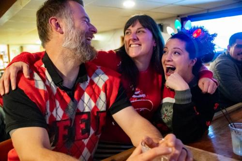 From left, Cordova Moose Lodge ugly sweater contest winner Micah Renfeldt with runners-up Cathy Renfeldt and Danaya Hoover. (Nov. 30, 2019) Photo by Zachary Snowdon Smith/The Cordova Times