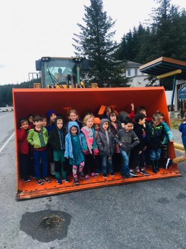 Mrs. Hall's Kindergarten class scooped up by the end loader on Monday, Dec. 9. Photo by Jane Phillips/for The Cordova Times