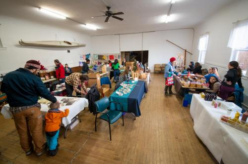 Shoppers peruse local goods at the monthly Saturday Market, held at the Masonic Lodge. (Dec. 21, 2019) Photo by Zachary Snowdon Smith/The Cordova Times