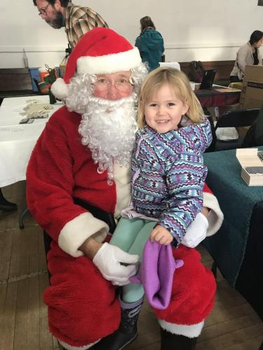 Josie Christian meets Santa Claus at the Saturday Market. (Dec. 21, 2019) Photo courtesy of Jessicca Hoover